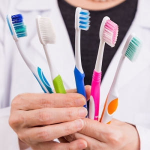 Which bristles of toothbrush should people who have corroded cavity or recessions use?